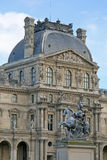 Fragment of one of facades of the royal Louvre palace in Paris Royalty Free Stock Images