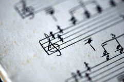 Fragment of the page of the old musical textbook. Close up Royalty Free Stock Image