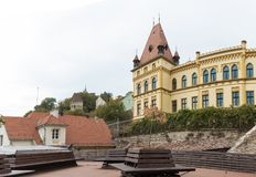 Fragment of the palace adjoining the clock tower in old  city of Sighisoara in Romania Royalty Free Stock Photography