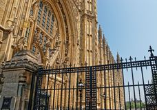 Fragment of Palace of Westminster and gates in London UK Stock Photos