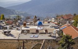 A fragment of the panorama of the city of Safed on a sunny day amid green hills. North of Israel. royalty free stock images