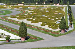 Fragment of the park in Ludwigsburg, Baden-Wurttemberg, Germany. Park composition of the bushes of the waveform and trees in pots Stock Photography