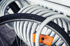 Fragment of a parked bicycle wheel Stock Images