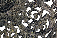 Fragment of a pattern of an ancient black plate Royalty Free Stock Photo
