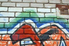 A fragment of the pattern on the brick wall, graffiti Royalty Free Stock Image