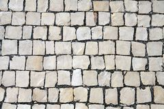 Fragment of a paved sidewalk Royalty Free Stock Photo