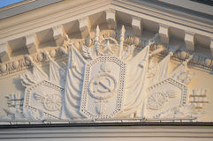 Fragment of Pediment. Decorated with classic standards and symbols Stock Photos
