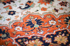 Fragment of the picture of wool carpet. Part of the pattern wool carpet royalty free stock photos