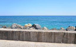Fragment of pier and Cretan Sea. Stock Photo