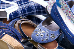Fragment of pile of blue female shoes Stock Photography