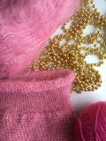 Fragment pink fluffy knitting sweater made from natural wool stock images