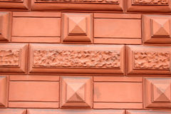 Fragment of a pink wall with an ornament Royalty Free Stock Images