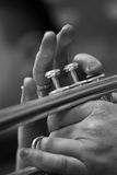 Fragment of a pipe in the hands of a musician Royalty Free Stock Photos