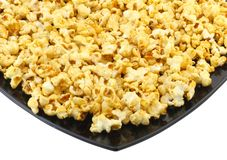 Fragment of plate with caramel popcorn. Isolated Stock Photography