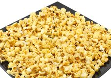 Fragment of plate with caramel popcorn. Isolated Royalty Free Stock Image