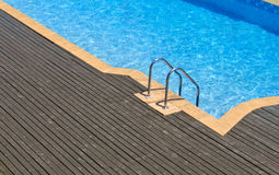 Fragment of pool with a ladder  Stock Images