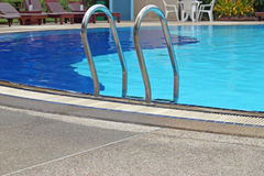 Fragment of pool with a ladder and water Stock Photography