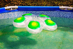 Fragment of the pool and rubber rubber ring on a water surface. Royalty Free Stock Photo