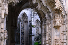 The fragment of the portal. The Monastery of Batalha, literally the Monastery of the Battle, is a Dominican convent in the civil parish of Batalha, in the stock photos