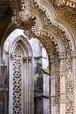 The fragment of the portal. The Monastery of Batalha, literally the Monastery of the Battle, is a Dominican convent in the civil parish of Batalha, in the royalty free stock image