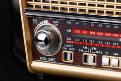 Fragment of radio receiver in retro style with radio dial and silver buttons Stock Photos