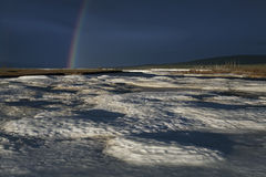 A fragment of a rainbow/. A fragment of a rainbow in the background of ice. Moma River. Yakutia. Russia Stock Photo
