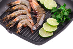 Fragment raw shrimps on frying pan. Stock Photography