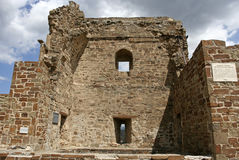 The fragment of the reconstructed stony tower in the medieval Genoese fortress. Royalty Free Stock Photo