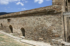 The fragment of the reconstructed stony wall in the medieval Genoese fortress. Stock Photos