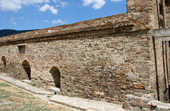 The fragment of the reconstructed stony wall in the medieval Genoese fortress. Royalty Free Stock Images