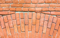 Fragment of a red brick wall with an arch. Royalty Free Stock Images