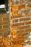 Fragment of a red brick wall began to crumble Royalty Free Stock Photo