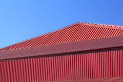 Fragment of the red metal roof Royalty Free Stock Images