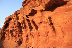Fragment of red sandstone on sunset Stock Photos