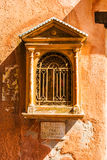 Fragment of red vintage old brick wall with icon Royalty Free Stock Photography