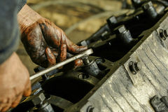 A fragment of the repair work on the disassembly of automotive engine Royalty Free Stock Photos