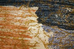 Fragment of retro colorful tapestry textile with vintage ornament useful as background.  Stock Photography