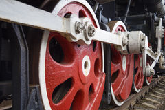 Fragment of a retro locomotive. Fragment of a retro locomotive on railway tracks Stock Photos