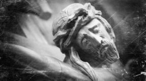Fragment of retro styled old wooden statue of crucifixion of Jesus Christ.  stock photography
