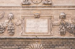 Close up of music academy facade. Fragment of richly decorated baroque facade of music academy, former Avignon`s Mint, Hotel des Monnaies, built in 17th century Royalty Free Stock Photo
