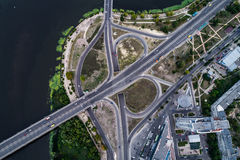 Fragment of the road junction in Kiev near the residential area of Rusanovka. Aerial view. From above Stock Photo