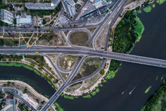 Fragment of the road junction in Kiev near the residential area of Rusanovka. Aerial view. From above Royalty Free Stock Images
