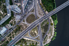 Fragment of the road junction in Kiev near the residential area of Rusanovka. Aerial view. From above Stock Photography