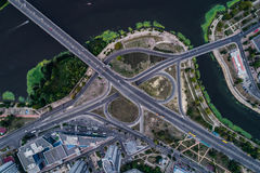 Fragment of the road junction in Kiev near the residential area of Rusanovka. Aerial view. From above Royalty Free Stock Photography