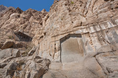 Fragment of the rock relief of Bisotun. Iranian memorial remains from the prehistoric times to the Median, Achaemenid, Sassanian,. IRAN: Fragment of the rock Stock Photo