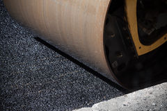Fragment of roller wheel, urban road is under construction Royalty Free Stock Photos
