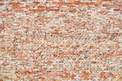 Fragment of rough brick wall Stock Images