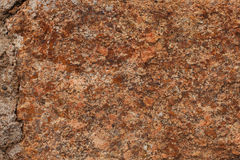 Fragment of rough brown stone Stock Image