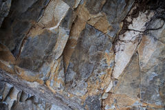Fragment of rough-hewn stone of dark gray Royalty Free Stock Photos