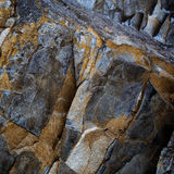 Fragment of rough-hewn stone of dark gray Royalty Free Stock Photography
